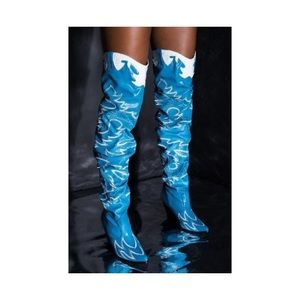 Blue and white thigh high cowboy boots